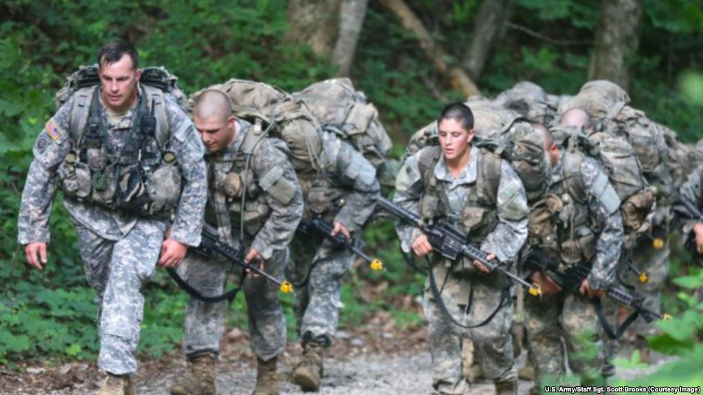 FILE - U.S. Army Ranger candidate soldiers, burdened with heavy packs and weapons, conduct Mountaineering training during the Ranger Course on Mount Yonah in Cleveland, Georgia, July 14, 2015.
